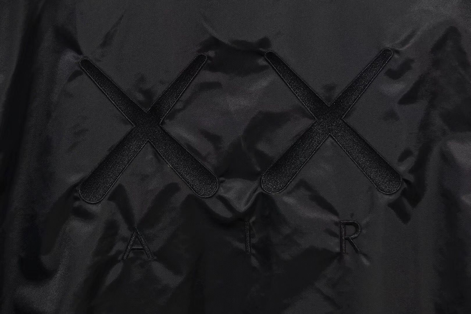 KAWS x Jordan Satin Coaches Jacket Black