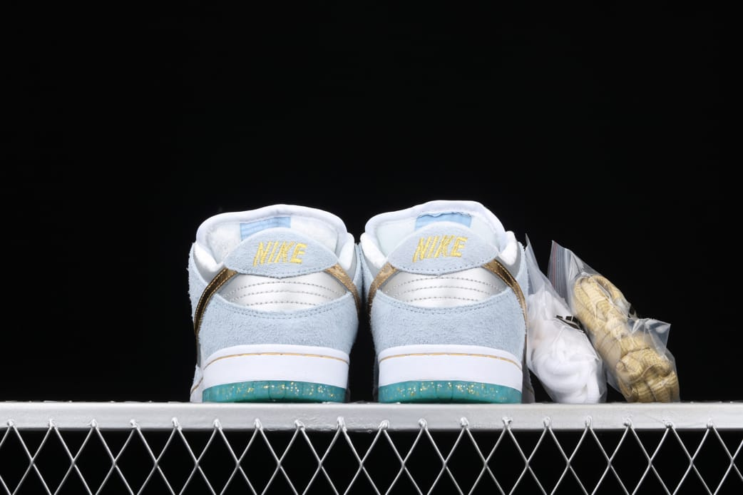 Sean Cliver x Nike Dunk Low SB Holiday Special 5
